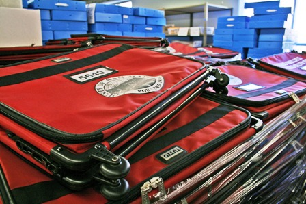 Red suitcases in Elections warehouse