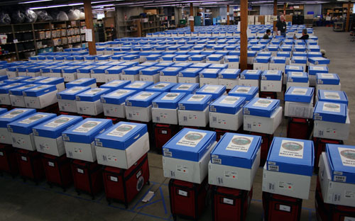 Red suitcase, white JBC boxes and blue ballot boxes lined up for Election Day