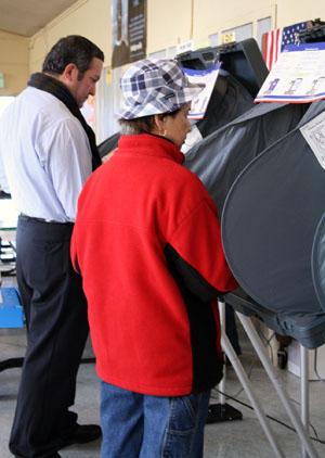 Voters voting on the eSlates at Woodrow Wilson School in DalyCity