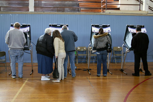 Voters voting on the eSlates at Spruce Elementary School in South SanFrancisco