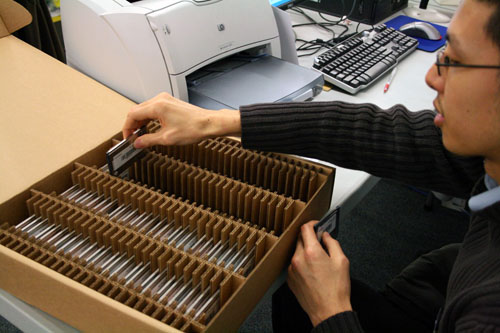 Memory cards storing electronic votes are assembled and readied to be read for vote tallying